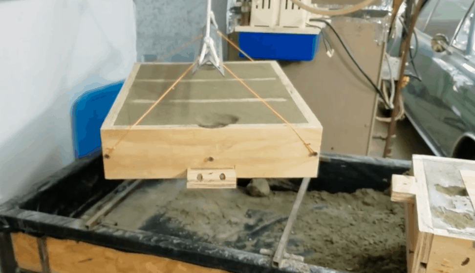 Hoist to help separate and roll large sand molds